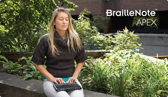 Girl using BrailleNote Apex QT 32