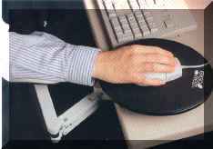 Man using Ergo Rest Mouse Pad next to keyboard