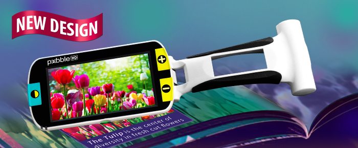 Pebble HD Handheld Magnifier looking at book with flowers