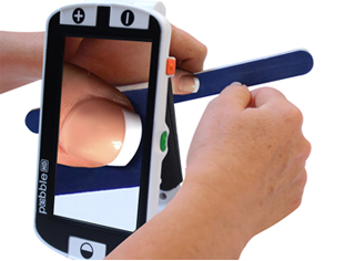 Pebble HD hand held video magnifier User Doing Nails