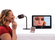 portable monitor with girl using lipstick