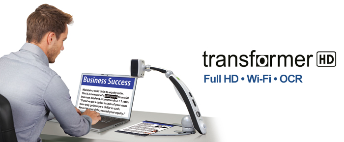 Transformer Video Magnifier at workstation with laptop