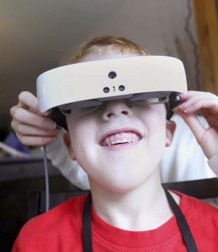 Young boy using eSight