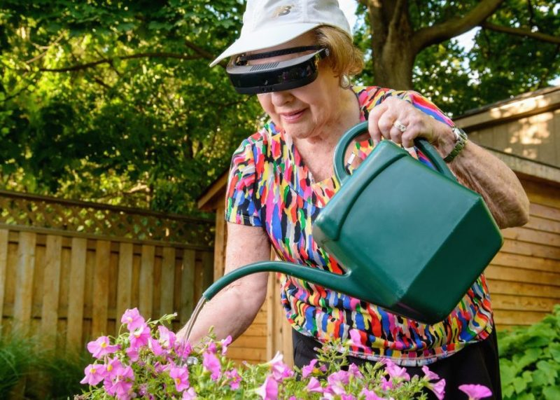 Lady using eSight to work in garden